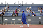 Students walks past applauding friends and family during a graduation ceremony at Millburn High School in Millburn, N.J., Wednesday, July 8, 2020. This week New Jersey saw the resumption of youth day camps, in-person summer school and school graduation ceremonies, capped at 500 people and required to be outside. (AP Photo/Seth Wenig)