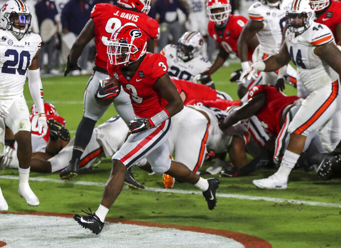 Georgia running back Zamir White (3) scores against Auburn during the first half of an NCAA college football game Saturday, Oct. 3, 2020, in Athens, Ga. (Curtis Compton/Atlanta Journal-Constitution via AP)