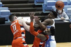Syracuse guard Joseph Girard III (11) and forward Quincy Guerrier struggle with North Carolina forward Day'Ron Sharpe, right, for a rebound during the first half of an NCAA college basketball game in Chapel Hill, N.C., Tuesday, Jan. 12, 2021. (AP Photo/Gerry Broome)