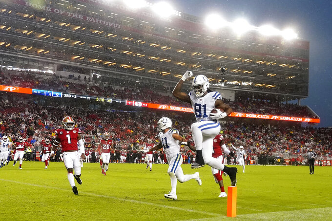 Indianapolis Colts tight end Mo Alie-Cox (81) jumps into the end zone to score against the San Francisco 49ers during the first half of an NFL football game in Santa Clara, Calif., Sunday, Oct. 24, 2021. (AP Photo/Tony Avelar)