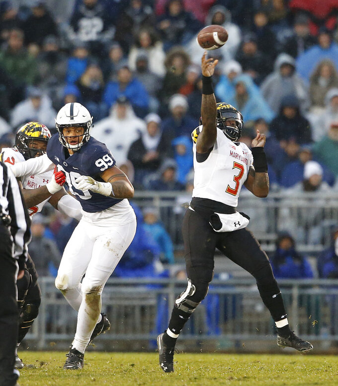 Maryland quarterback Tyrrell Pigrome (3) throws a pass against Penn State during the first half of an NCAA college football game in State College, Pa., Saturday, Nov. 24, 2018. (AP Photo/Chris Knight)