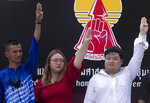 Pro democracy student leaders of United Front of Thammasat and Demonstration, from left Panupong Jadnok, Panusaya Sithijirawattanakul, and Parit Chiwarak raise a three-fingers salute, a symbol of resistance after announcing the pro-democracy movement's rally scheduled for Sept. 19, 2020 at Thammasat University Bangkok, Thailand, Wednesday, Sept. 9, 2020. A two-day rally planned for this weekend is jangling nerves in Bangkok, with apprehension about how far student demonstrators will go in pushing demands for reform of Thailand's monarchy and how the authorities might react. More than 10,000 people are expected to attend the Saturday-Sunday event.  (AP Photo/Sakchai Lalit)