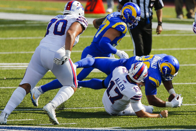 Los Angeles Rams' Aaron Donald recovers the ball after sacking Buffalo Bills' Josh Allen (17) during the second half of an NFL football game Sunday, Sept. 27, 2020, in Orchard Park, N.Y. (AP Photo/John Munson)