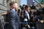 Mixed martial arts figher Conor McGregor is escorted by court officers as he leaves a Brooklyn Supreme court, Thursday, June 14, 2018, in New York.  McGregor is in plea negotiations to resolve charges stemming from a backstage melee at a Brooklyn arena. The 29-year-old Irish fighter and co-defendant Cian Cowley remained free on bail after a brief court appearance on Thursday. They are due back in court July 26.  (AP Photo/Mary Altaffer)