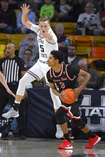 Fresno State guard Jarred Hyder (3) looks to pass the ball as Utah State guard Sam Merrill (5) defends during the first half of an NCAA college basketball game Saturday, Dec. 7, 2019, in Logan, Utah. (AP Photo/Eli Lucero)