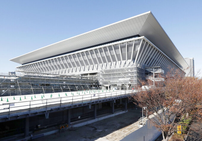 In this Nov. 21, 2019, photo, Tokyo Aquatics Center, a venue for swimming and diving at the Tokyo 2020 Summer Olympics, is seen in Tokyo. (Yukie Nishizawa/Kyodo News via AP, File)