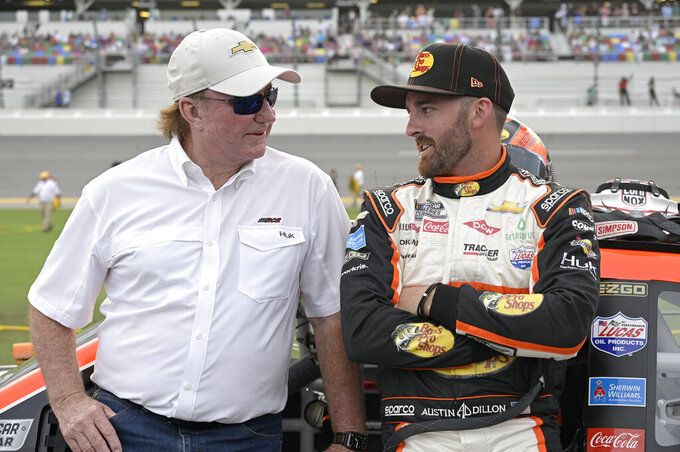 Austin Dillon stands next to his vehicle with car owner Richard Childress, left, on pit road before a NASCAR Cup Series auto race at Daytona International Speedway, Saturday, Aug. 28, 2021, in Daytona Beach, Fla. (AP Photo/Phelan M. Ebenhack)