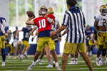 Drew Pyne during warms up during Notre Dame NCAA college football practice in South Bend, Ind., Thursday, Aug. 12, 2021. (Michael Caterina/South Bend Tribune via AP)