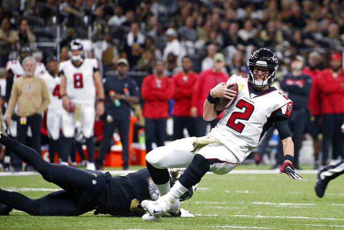 Atlanta Falcons quarterback Matt Ryan (2) is tackled by New Orleans Saints outside linebacker Demario Davis in the first half of an NFL football game in New Orleans, Sunday, Nov. 10, 2019. (AP Photo/Butch Dill)