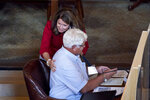 Nebraska state Sen. Suzanne Geist, of Lincoln, hugs Sen. Mike Groene, of North Platte, following the passage of her bill, LB814, to prohibit the dilation and evacuation procedure during an abortion, in Lincoln, Neb., Thursday, Aug. 13, 2020, on the last day of a legislative session marked by major disruptions from the coronavirus and political feuds that often turned personal. (AP Photo/Nati Harnik)