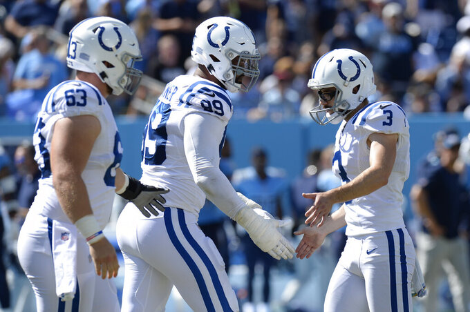 Indianapolis Colts kicker Rodrigo Blankenship (3) is congratulated by DeForest Buckner (99) after Blankenship kicked a 28-yard field goal against the Tennessee Titans in the second half of an NFL football game Sunday, Sept. 26, 2021, in Nashville, Tenn. (AP Photo/Mark Zaleski)