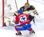 Boston Bruins goaltender Jaroslav Halak (41) stops Montreal Canadiens left wing Artturi Lehkonen (62) during third period NHL hockey action in Montreal on Monday, Dec. 17, 2018. (Ryan Remiorz/The Canadian Press via AP)
