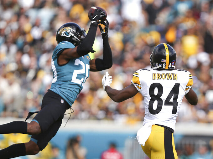 "FILE - In this Nov. 18, 2018, file photo, Jacksonville Jaguars cornerback Jalen Ramsey, left, intercepts a pass in front of Pittsburgh Steelers wide receiver Antonio Brown (84) during the first half of an NFL football game in Jacksonville, Fla. Ramsey responded to Tom Coughlin's public criticism Friday, April 19, saying the team knows why he's skipping voluntary workouts. Ramsey did not elaborate on the reason for his absence in his Twitter post, but said he will be ""ready when it's time."" (AP Photo/Gary McCullough, File)"