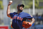 Houston Astros pitcher Josh James delivers to the Boston Red Sox during a spring training baseball game, Thursday, March 5, 2020, in Fort Myers, Fla. (AP Photo/Elise Amendola)