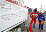 The circuit information board shows the cancelation for the Oct. 12 schedule at the Japanese Formula One Grand Prix at Suzuka Circuit in Suzuka, central Japan, Friday, Oct. 11, 2019. A powerful typhoon was forecast to bring 2 feet of rain and damaging winds to the Tokyo area this weekend, and Japan's government warned people Friday to stockpile supplies and evacuate before it's too dangerous. (Kyodo News via AP)