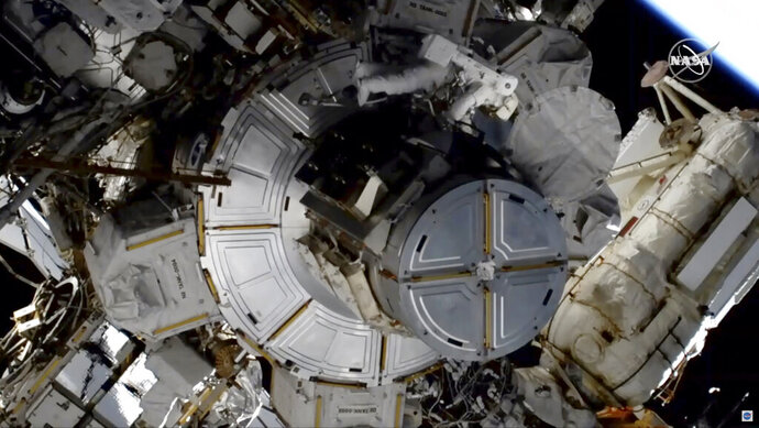 In this image taken from NASA video NASA astronaut Jessica Meir works to finish upgrading the International Space Station's power grid, Wednesday, Jan. 15, 2020. NASA is in the midst of replacing decades-old nickel-hydrogen batteries outside the sprawling space station with more powerful, longer-lasting lithium-ion batteries. The batteries are part of the station's solar power network, keeping everything running when the outpost is on the night side of Earth. It was the second pairing of Meir and Christina Koch outside the orbiting lab. (NASA via AP)