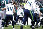 Seattle Seahawks' Russell Wilson passes for a touchdown during the first half of an NFL football game against the Philadelphia Eagles, Sunday, Nov. 24, 2019, in Philadelphia. (AP Photo/Matt Rourke)
