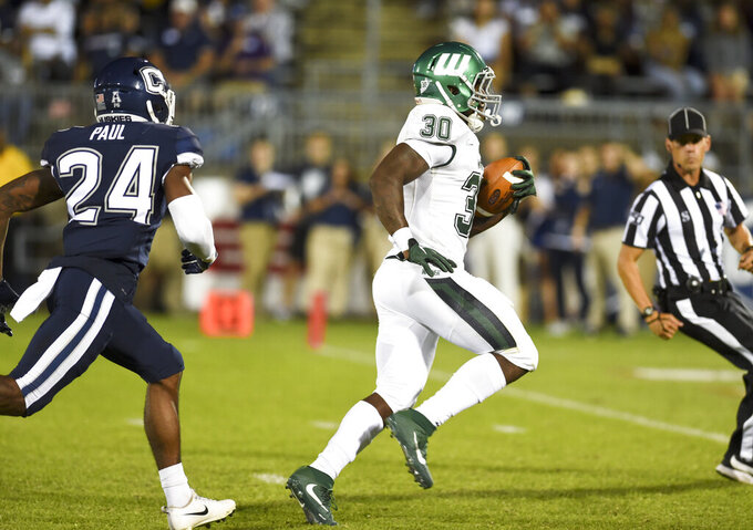 Wagner running back Dymitri McKenzie (30) scores during the second half of the team's NCAA college football game against Connecticut on Thursday, Aug. 29, 2019, in East Hartford, Conn. (AP Photo/Stephen Dunn)