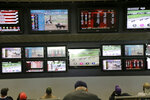 FILE - In this Monday, May 14, 2018, file photo, men watch horse racing on an array of screens at Monmouth Park Racetrack in Oceanport, N.J. Now that the U.S. Supreme Court has cleared the way for states to legalize sports betting, the race is on to see who will referee the multi-billion-dollar business expected to emerge from the decision.(AP Photo/Seth Wenig, File)