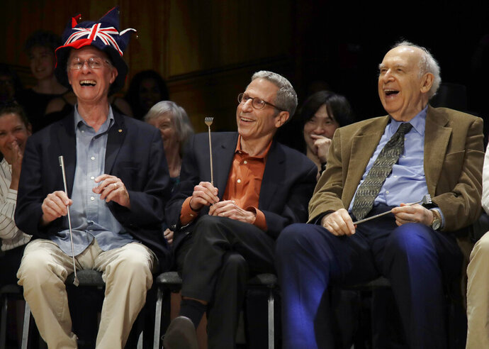 From left, Nobel Laureates Rich Roberts (Medicine, 1993), Eric Maskin (Economics, 2007), and Jerome Friedman (Physics, 1990) laugh during the 29th annual Ig Nobel awards ceremony at Harvard University, Thursday, Sept. 12, 2019, in Cambridge, Mass. The spoof prizes for weird and sometimes head-scratching scientific achievement are bestowed by the Annals of Improbable Research magazine, and handed out by real Nobel laureates. (AP Photo/Elise Amendola)