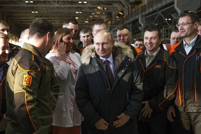 "FILE - In this March 6, 2018, file photo, Russian President Vladimir Putin listens to employees of Uralvagonzavod factory in Nizhny Tagil, Russia. In 2011, Nizhny Tagil - an industrial city some 1,400 kilometers (870 miles) east of Moscow - was nicknamed ""Putingrad"" for its residents' fervent support of the president. Now, however, workers who once defended Putin are speaking out against the constitutional reforms that would allow him to stay in office until 2036. (AP Photo/Alexander Zemlianichenko, File)"