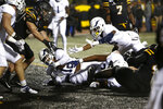 Georgia Southern running back Wesley Kennedy III (12) falls into the end zone for a touchdown during the first half of the team's NCAA college football game against Appalachian State on Thursday, Oct. 31, 2019, in Boone, NC. (AP Photo/Brian Blanco)