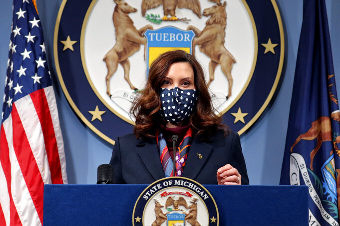 FILE- This March 2, 2021 file photo provided by the Michigan Office of the Governor, Gov. Gretchen Whitmer addresses the state during a speech in Lansing, Mich. Gov. Whitmer on Wednesday, March 31, 2021, doubled Michigan's daily COVID-19 vaccination goal to 100,000 shots. She cited continuous week-over-week increases in vaccine allotments the state is receiving and an expanded number of providers who can administer doses. (Michigan Office of the Governor via AP, File)