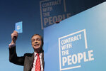 "FILE - In this Friday, Nov. 22, 2019 file photo, Nigel Farage, leader of Britain's Brexit Party poses for photographers after speaking on stage at the launch of their policies for the General Election campaign, in London.  Farage, the self-declared ""pantomime villain"" of Brexit, told the Associated Press Tuesday Jan. 14, 2020, he is leaving the European Union's parliament in Strasbourg later this week with a sense of mission accomplished. (AP Photo/Kirsty Wigglesworth, File)"