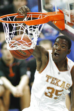 FILE - In this March 10, 2007, file photo, Texas guard Kevin Durant (35) dunks against Oklahoma State during the first half of a semifinal basketball game at the Big 12 Conference Tournament in Oklahoma City. Durant was a consensus national player of the year his lone season at Texas. (AP Photo/Ty Russell, File)