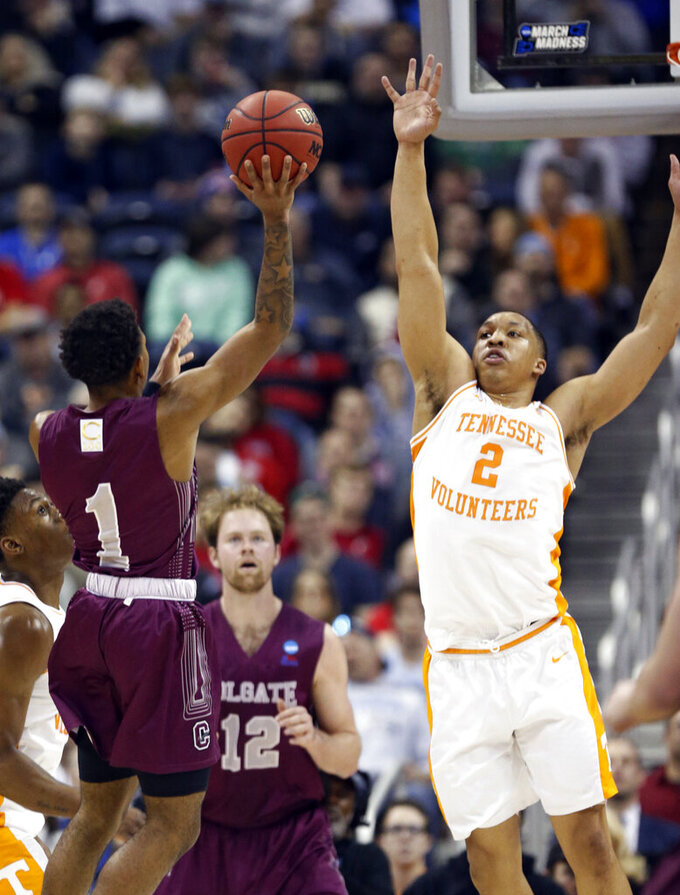 Colgate's Jordan Burns (1) shoots over Tennessee's Grant Williams (2) in the first half during a first-round game in the NCAA men's college basketball tournament in Columbus, Ohio, Friday, March 22, 2019. (AP Photo/Paul Vernon)