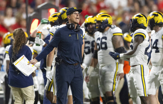 Michigan coach Jim Harbaugh yells to officials during a timeout in the first half of an NCAA college football game against Nebraska on Saturday, Oct. 9, 2021, in Lincoln, Neb. (AP Photo/Rebecca S. Gratz)