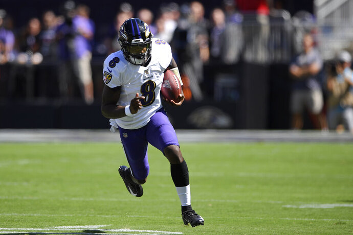 Baltimore Ravens quarterback Lamar Jackson rushes the ball in the first half of an NFL football game against the Arizona Cardinals, Sunday, Sept. 15, 2019, in Baltimore. (AP Photo/Nick Wass)
