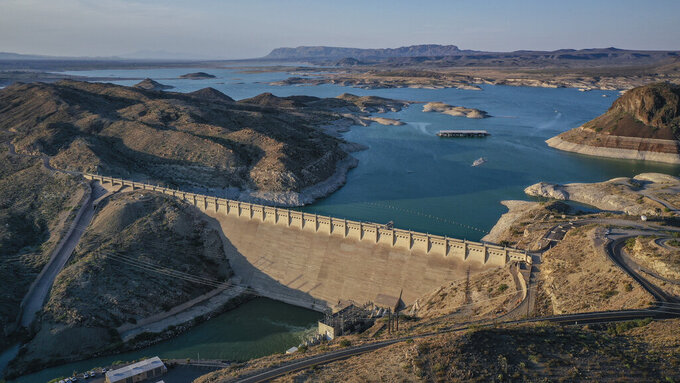 FILE - This undated file photo shows the dam at Elephant Butte Lake in Elephant Butte, N.M. Many New Mexico communities are behind the curve when it comes to investing in drinking water infrastructure as persistent drought threatens supplies, and the state's fragmented funding process makes it hard to know what taxpayers are getting for their money, legislative analysts said Wednesday, June 23, 2021. (Roberto E. Rosales/The Albuquerque Journal via AP, File)