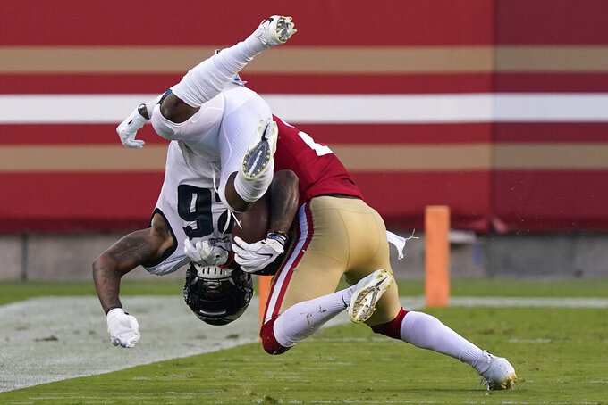 Philadelphia Eagles running back Miles Sanders, left, is tackled by San Francisco 49ers free safety Jimmie Ward during the first half of an NFL football game in Santa Clara, Calif., Sunday, Oct. 4, 2020. (AP Photo/Tony Avelar)