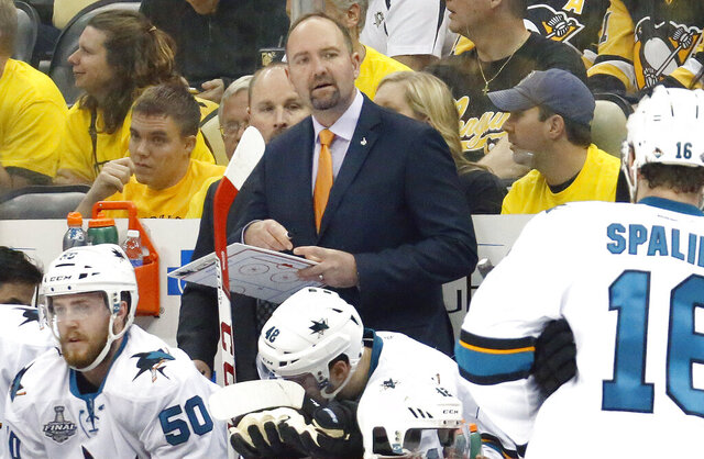 FILE - In this Monday, May 30, 2016 file photo, San Jose Sharks head coach Peter DeBoer watches action from the bench during the first period in Game 1 of the Stanley Cup final against the Pittsburgh Penguins series in Pittsburgh. The San Jose Sharks have fired coach Peter DeBoer, a person with direct knowledge of the move said, Wednesday, Dec. 11, 2019. The person spoke to The Associated Press on condition of anonymity because the firing hadn't been formally announced. (AP Photo/Keith Srakocic, File)