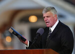 """FILE - In this March 2, 2018 file photo, Pastor Franklin Graham speaks during a funeral service at the Billy Graham Library for the Rev. Billy Graham, who died last week at age 99 in Charlotte, N.C.  Graham has denounced the impeachment investigation of President Donald Trump,  but this week asked followers to """"pray w/me"""" that Trump would reconsider his ceding of Syrian territory to Turkey.   (AP Photo/John Bazemore, File)"""