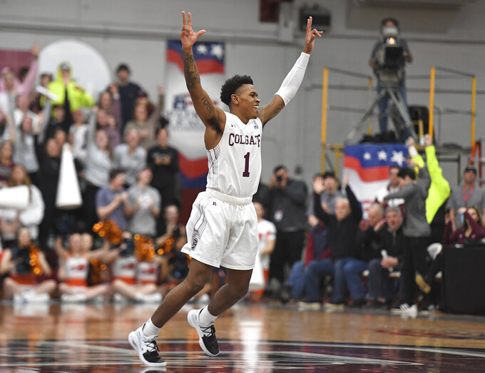 Colgate guard Jordan Burns celebrates a basket during the second half of an NCAA college basketball game against Bucknell for the championship of the Patriot League men's tournament in Hamilton, N.Y., Wednesday, March 13, 2019. Colgate won 94-80. (AP Photo/Adrian Kraus)