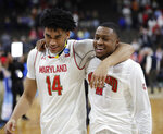 Maryland 's Ricky Lindo Jr. (14) and Travis Valmon walk off the court after defeating Belmont 79-77 in a first round game in the NCAA college basketball tournament in Jacksonville, Fla., Thursday, March 21, 2019. (AP Photo/John Raoux)