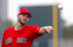 Boston Red Sox starting pitcher Chris Sale warms up as pitchers and catchers report for their first workout at their spring training baseball facility in Ft. Myers, Fla., Wednesday, Feb. 13, 2019. (AP Photo/Gerald Herbert)