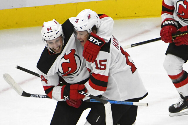 New Jersey Devils center John Hayden (15) celebrates his goal against the Chicago Blackhawks with left wing Miles Wood (44) during the second period of an NHL hockey game Monday, Dec. 23, 2019, in Chicago. (AP Photo/David Banks)