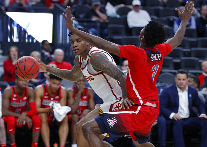 Southern California's Kevin Porter Jr., left, drives into Arizona's Dylan Smith during the first half of an NCAA college basketball game in the first round of the Pac-12 conference tournament Wednesday, March 13, 2019, in Las Vegas. (AP Photo/John Locher)