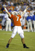 FILE -  In this Sept. 6, 2003 file photo, Miami quarterback Brock Berlin celebrates a touchdown by Frank Gore putting Miami ahead of Florida during the last moments of the fourth quarter of a NCAA college football game at the Orange Bowl in Miami. The Florida-Miami series has been one-sided of late. The Hurricanes have won seven of the last eight and 12 of 16. But the teams separated by 300 miles have provided several instant classics and plenty of hard feelings over the previous 80 years. (AP Photo/Wilfredo Lee, File)