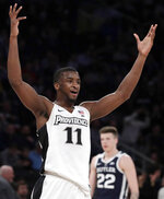 Providence guard Alpha Diallo reacts after a basket against Butler during the second half of an NCAA college basketball game in the Big East men's tournament Wednesday, March 13, 2019, in New York. Providence won 80-57. (AP Photo/Julio Cortez)