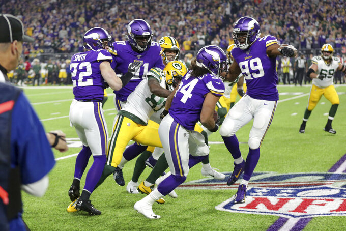 Minnesota Vikings middle linebacker Eric Kendricks (54) returns a fumble during the first half against the Green Bay Packers in an NFL football game Monday, Dec. 23, 2019, in Minneapolis. (AP Photo/Andy Clayton-King)