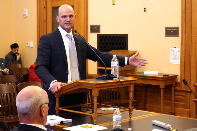 Kansas Secretary of State Scott Schwab speaks to legislators from south-central Kansas about implementing a 2019 law that permits counties to allow voters to cast their ballots at any polling place, Wednesday, Feb. 12, 2020, at the Statehouse in Topeka, Kan. The Republican secretary of state says his office needs another year to draft the regulations to ensure that electronic voter registration records remain secure and county computer systems can handle and update all records at once. (AP Photo/John Hanna)