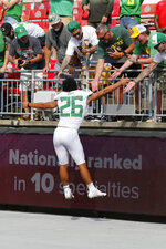 Oregon running back Travis Dye celebrates with fans after their 35-28 win over Ohio State in an NCAA college football game Saturday, Sept. 11, 2021, in Columbus, Ohio. (AP Photo/Jay LaPrete)