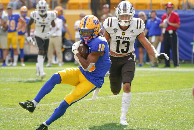 Pittsburgh wide receiver Jaylon Barden (10) makes a catch and takes it past Western Michigan linebacker Harrison Taylor (13) for a touchdown during the second half of an NCAA college football game, Saturday, Sept. 18, 2021, in Pittsburgh. Western Michigan won 44-41. (AP Photo/Keith Srakocic)