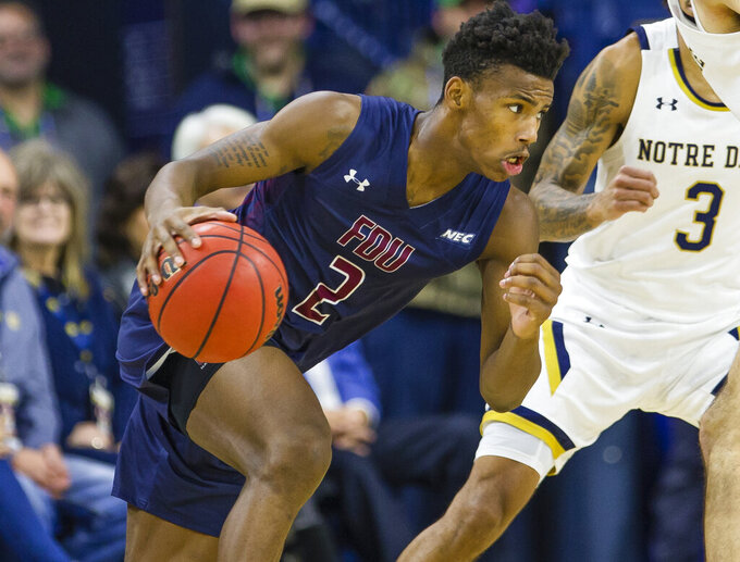 Fairleigh Dickinson's Brandon Rush (2) drives to the basket during an NCAA college basketball game against Notre Dame Tuesday, Nov. 26, 2019, in South Bend, Ind. (Michael Caterina/South Bend Tribune via AP)