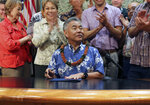 FILE - In this June 13, 2018 file photo, Hawaii lawmakers applaud after Gov. David Ige, who is running for a second term in office, signed legislation in Honolulu. Ige faces a stiff challenge in the Democratic primary on Saturday, Aug. 11, 2018, from U.S. Rep. Colleen Hanabusa, who is giving up her seat in Congress to block him from a second term. (AP Photo/Audrey McAvoy, File)