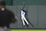 Kansas City Royals center fielder Michael A. Taylor can't catch a home run by Cleveland Indians' Amed Rosario during the seventh inning of a baseball game Tuesday, Aug. 31, 2021, in Kansas City, Mo. (AP Photo/Reed Hoffmann)
